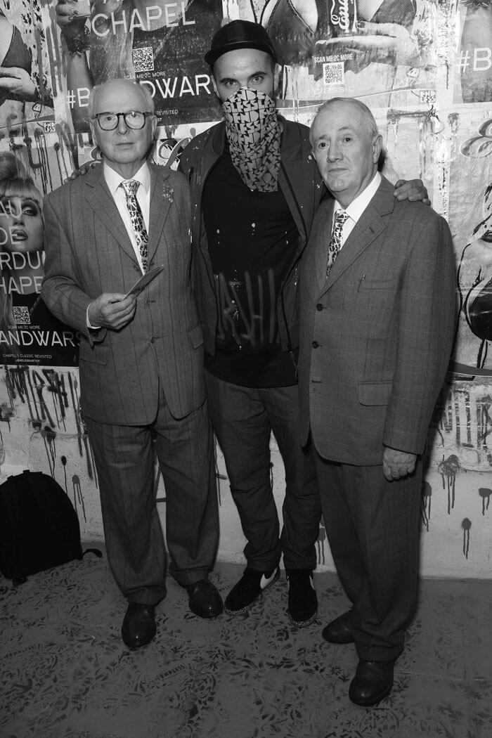 "Gilbert & George with Endless at the opening of the Endless solo exhibition ""Worship""."